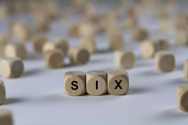 Six - cube with letters, sign with wooden cubes. Series of images: cube with letters, sign with wooden cubes royalty free stock photos