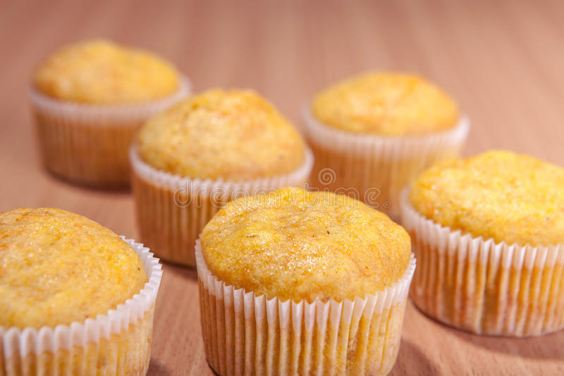 Six cupcakes on wood texture table royalty free stock photos