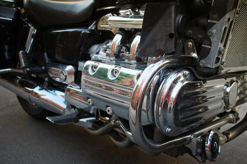 Six-cylinder internal combustion engine of a motorcycle. Close-up of a big powerful six-cylinder internal combustion engine of a motorcycle royalty free stock photo
