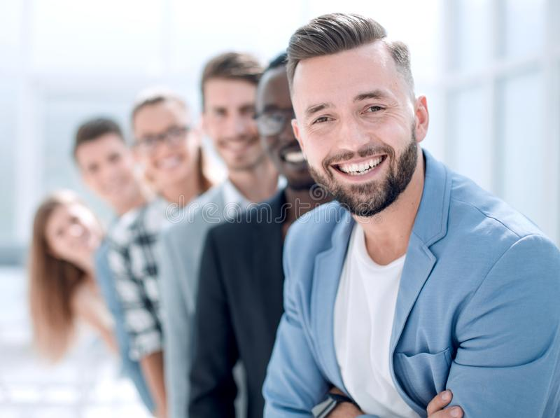 Six different people standing in a row. royalty free stock photography