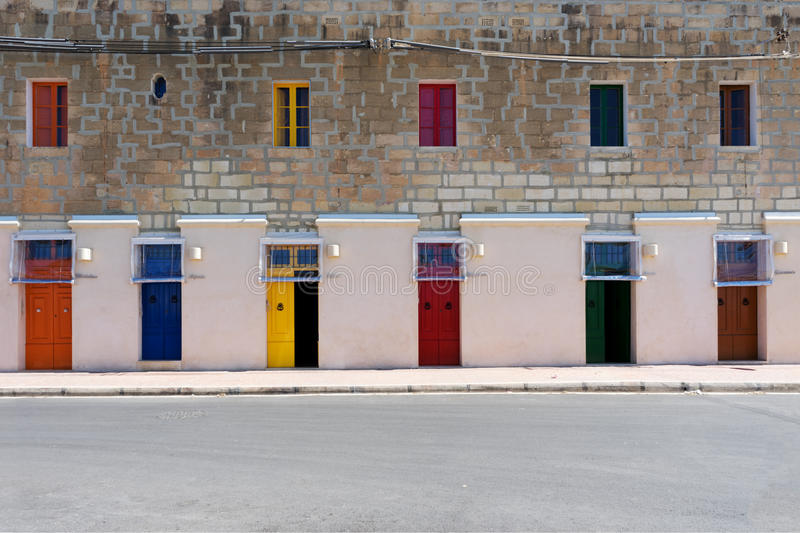 Six Doors. Six colorfull doors in a row in the harbour of Marsaxlokk, Malta royalty free stock photography
