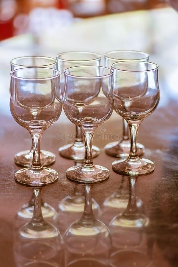 Six empty crystal wine glasses