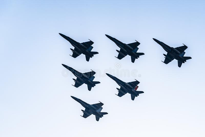Six F18 Hornet jet fighters flying a blue sky day royalty free stock photography