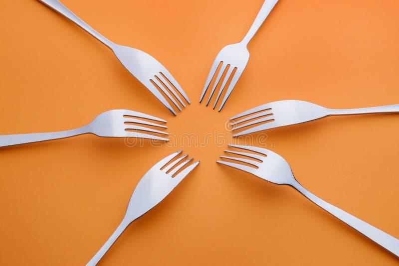 Six forks on orange royalty free stock photo