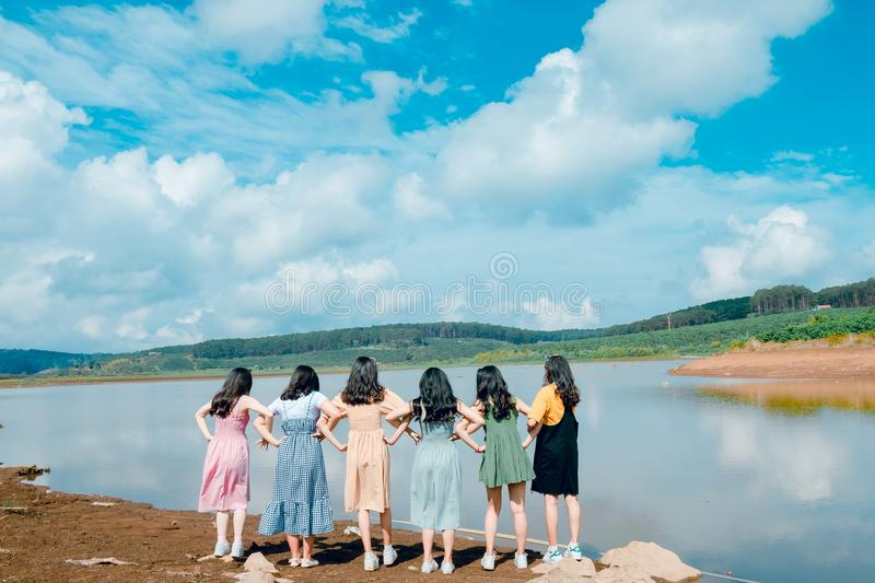 Six Girl's Standing in Front of Lake royalty free stock images