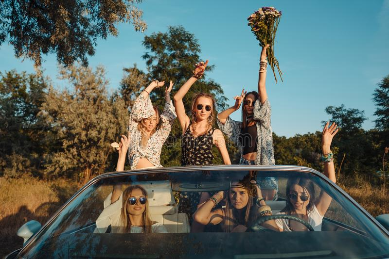 Six girls have fun in the countryside stock photos