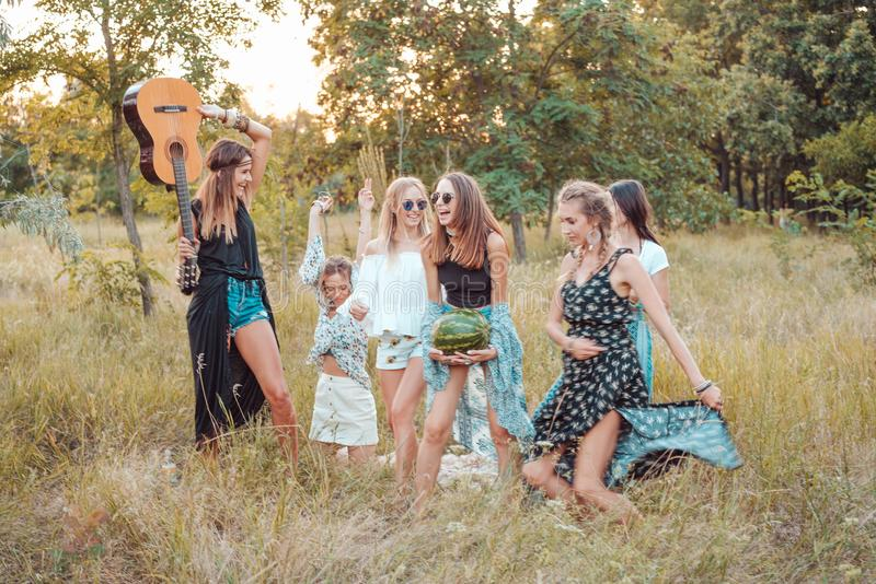 Six girls in nature have fun stock photos
