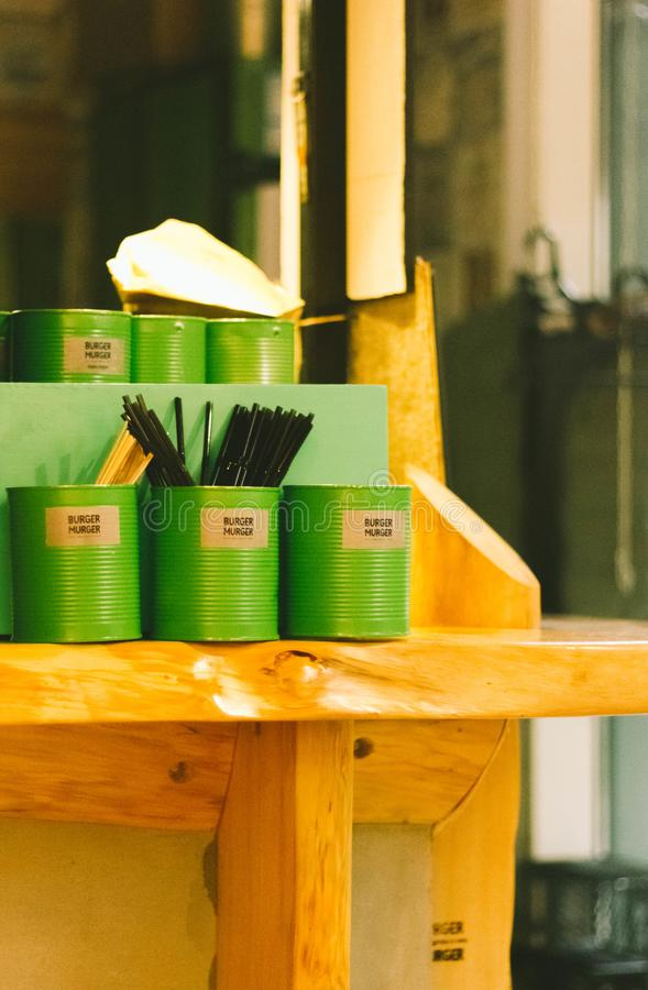 Six Green Tin Can Containers on Table royalty free stock photo
