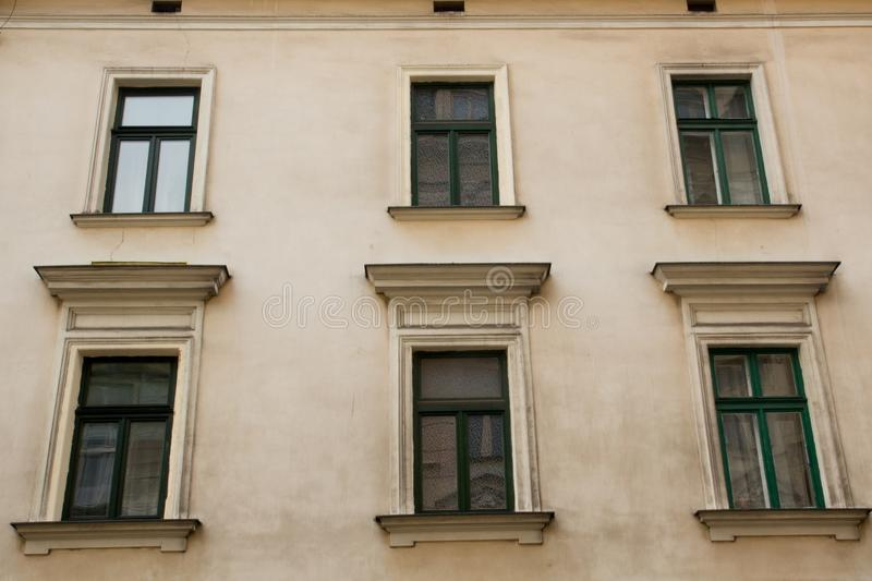 Six green Windows on the facade of a historic building.  stock images