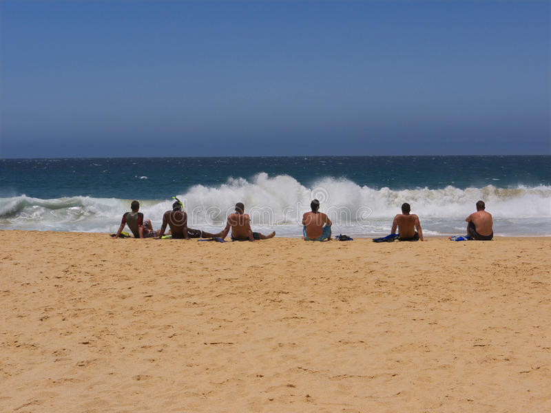Download Six guys watching the surf editorial photo. Image of blue - 22963851