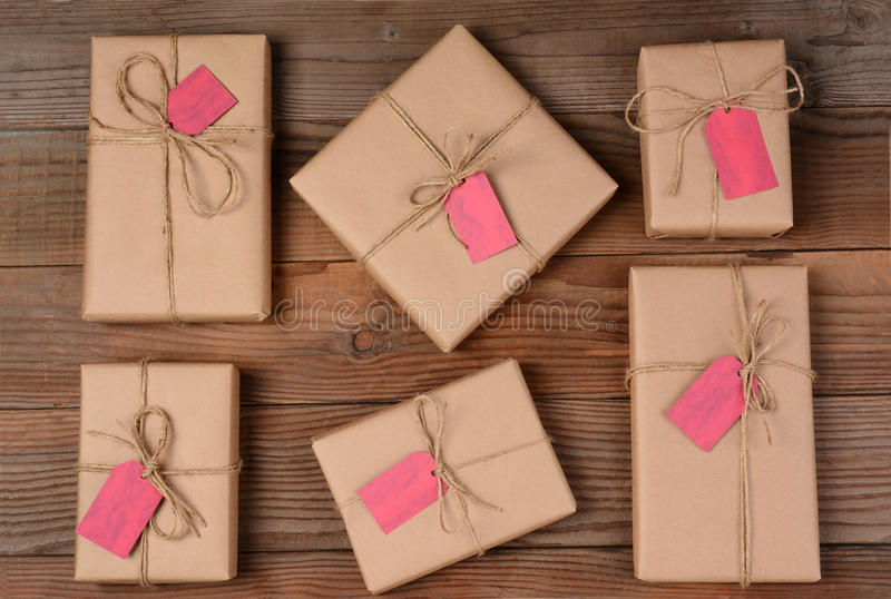 Six Holiday Packages on Wood Surface royalty free stock photo