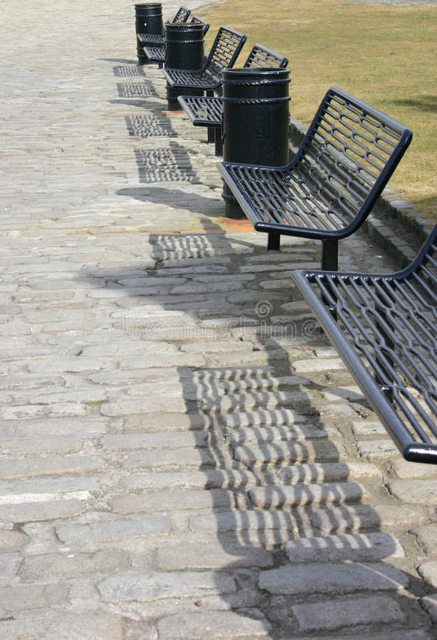 Six Iron Benches royalty free stock image