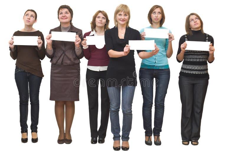 Six jeunes beaux femmes représentent. images stock