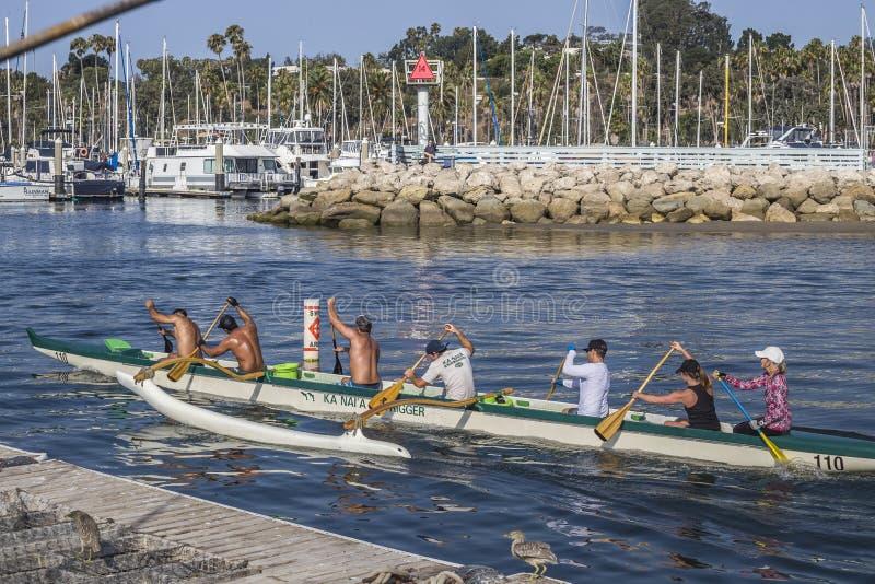 Six Kanai Outrigger Team members paddling at the Santa Barbara coast, California royalty free stock photo
