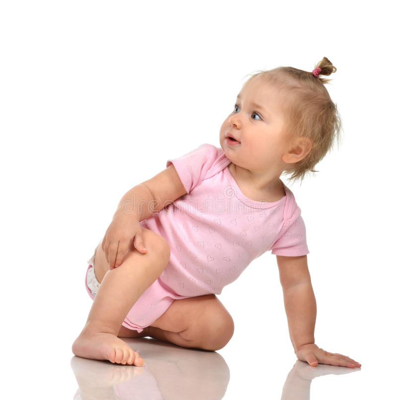 Six month infant child baby toddler sitting in pink body and diaper stock photography