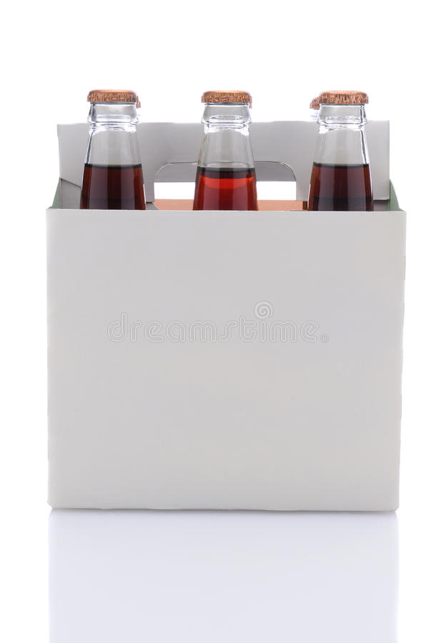 Six Pack of Cola Soda Bottles. Side view of a six pack of Cola soda bottles over a white background with reflection royalty free stock images