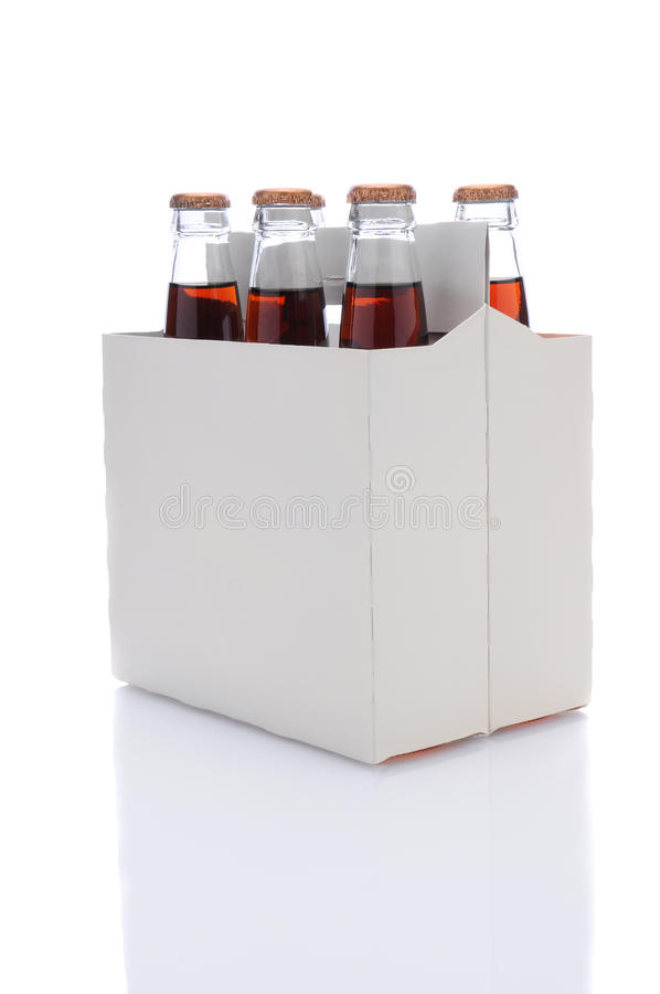 Six Pack of Cola Soda Bottles. Three quarters view of a six pack of Cola soda bottles over a white background with reflection stock images