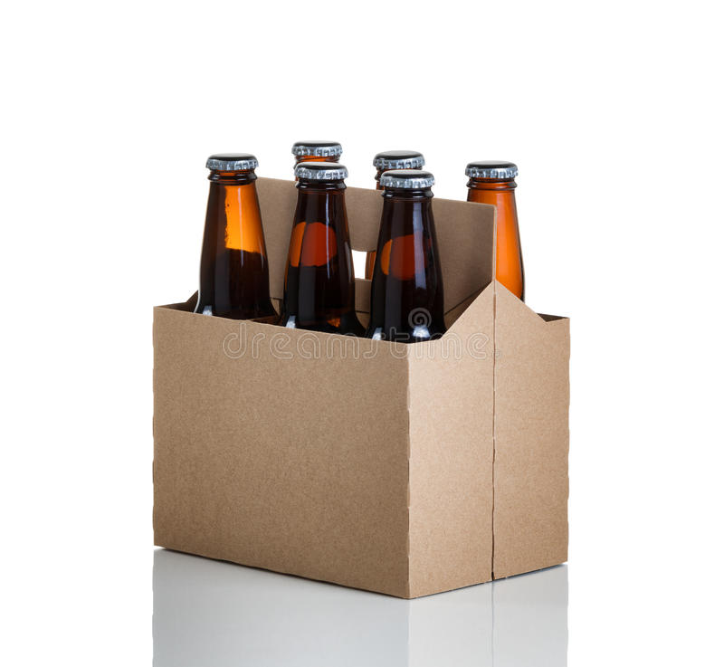 Six pack of glass bottled beer in generic brown cardboard carrie stock photography