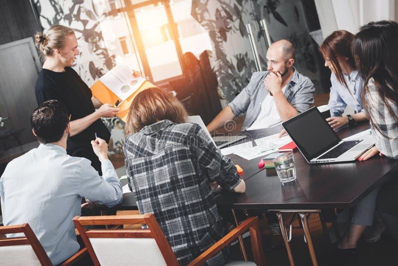 Six people working in loft space. Coworking startup meeting. Tea stock photos