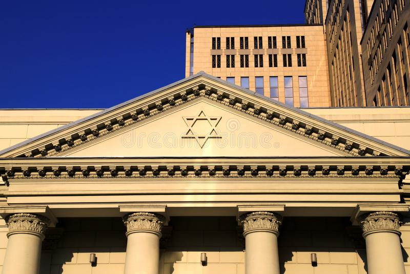 The six-pointed Jewish star of David on the facade of the synagogue, a symbol of the Jews. Dnipro city, Ukraine. The six-pointed Jewish star of David on the stock photo