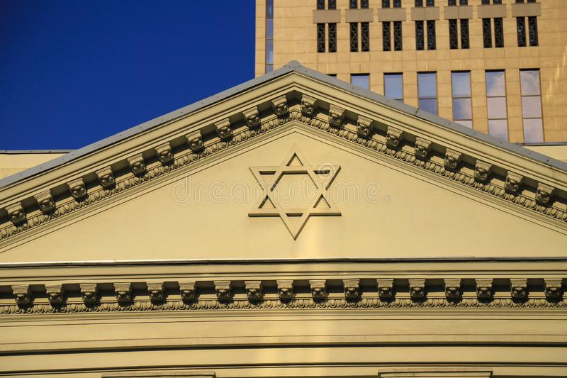 The six-pointed Jewish star of David on the facade of the synagogue, a symbol of the Jews. The six-pointed Jewish star of David on the facade of the synagogue royalty free stock photos