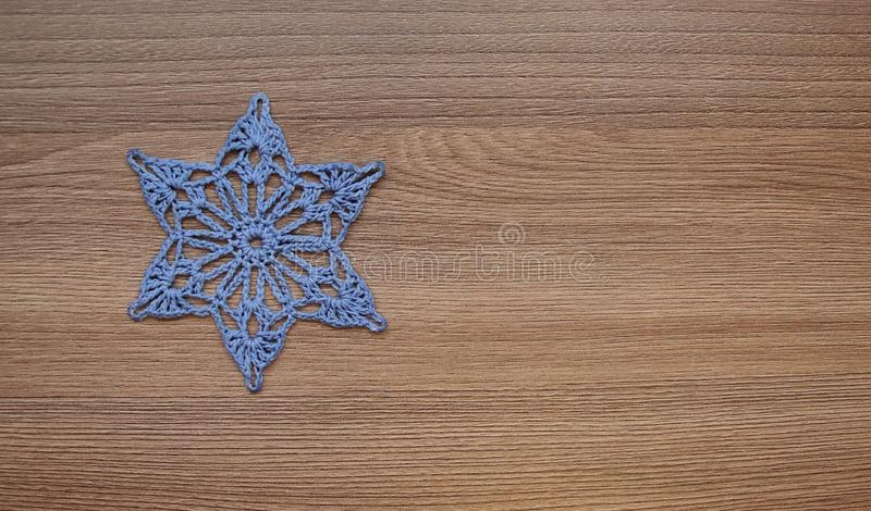 Six-pointed star embroidered from threads royalty free stock photography