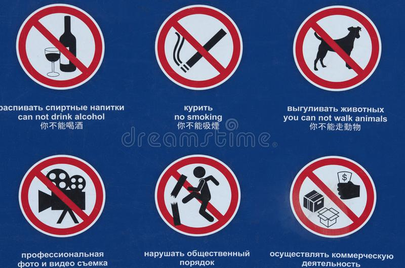 Six prohibiting signs with widespread symbols. Six prohibiting public signs with widespread symbols and inscriptions in Chinese, English and Russian royalty free stock photos