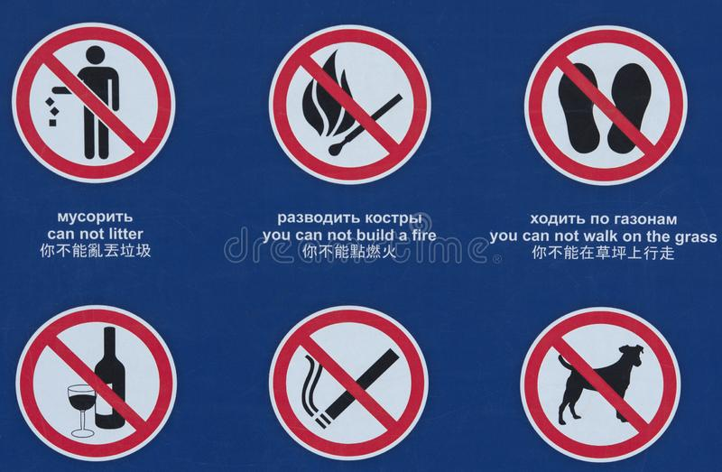 Six prohibiting signs with widespread symbols. Six prohibiting public signs with widespread symbols and inscriptions in Chinese, English and Russian royalty free stock images