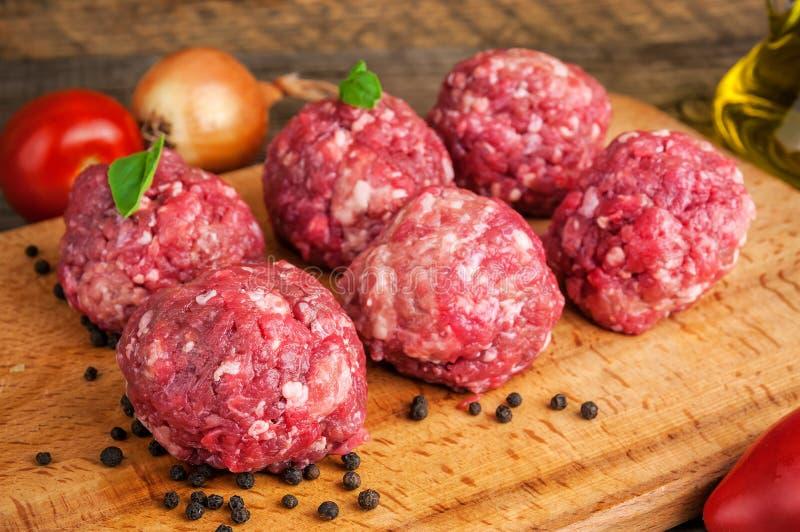 Six raw meatballs stock photo