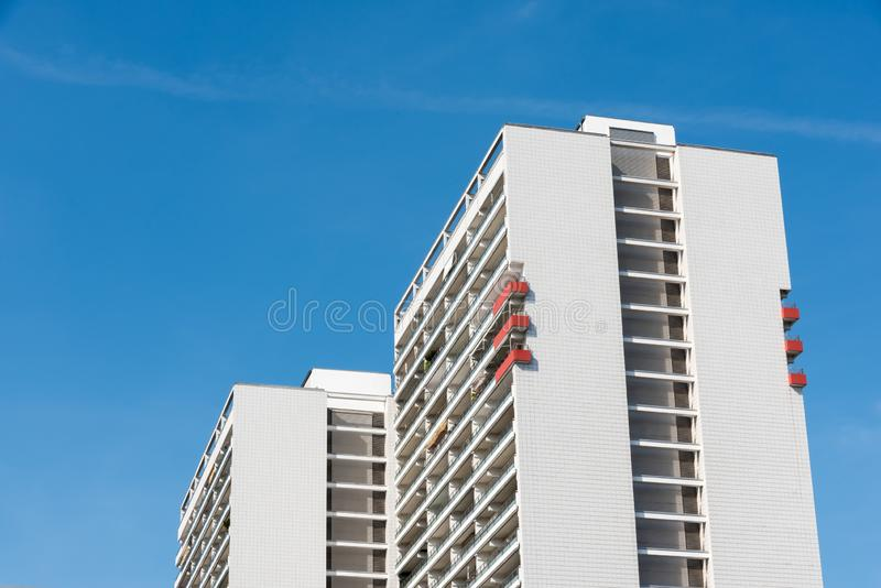 The six red balconies on the apartment building. On a sunny day royalty free stock photo
