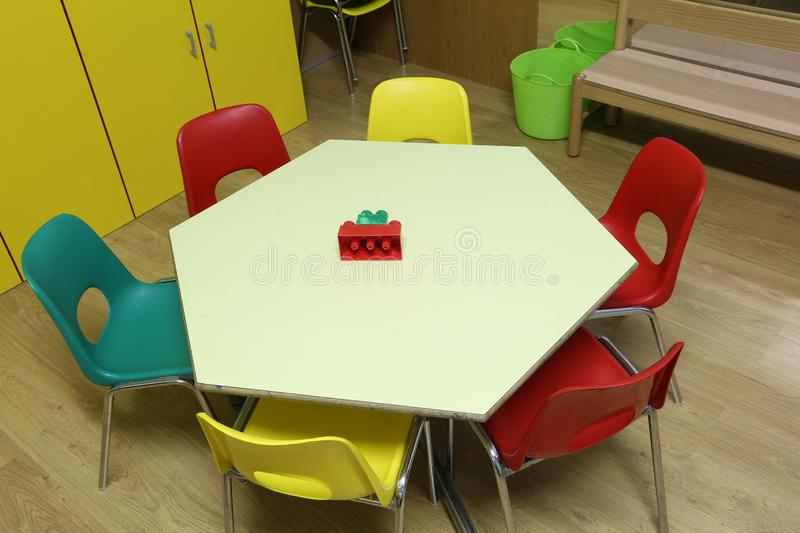 Six small chairs and an hexagonal table stock image