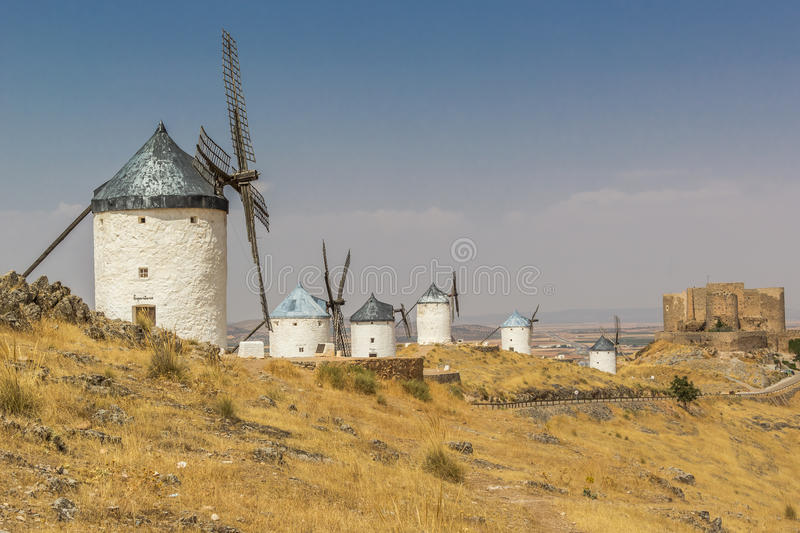 Six Spanish windmills in a row royalty free stock photos