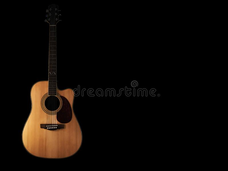 Six - string acoustic guitar  on a black background. low key. Music day stock images