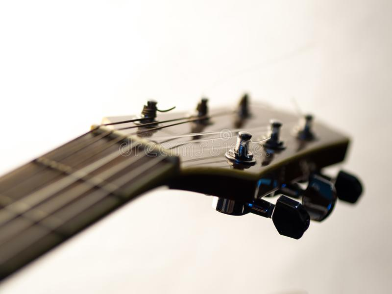 Six - string acoustic guitar on a white background. Music day royalty free stock photography