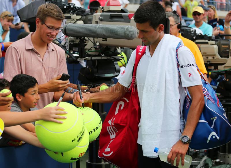 Six times Grand Slam champion Novak Djokovic signing autographs after US Open 2014 match. NEW YORK - SEPTEMBER 1: Six times Grand Slam champion Novak Djokovic royalty free stock images