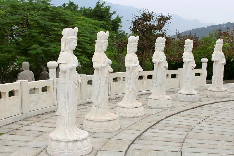 Six white marble Buddha statues in a natural ambiance, China royalty free stock photos