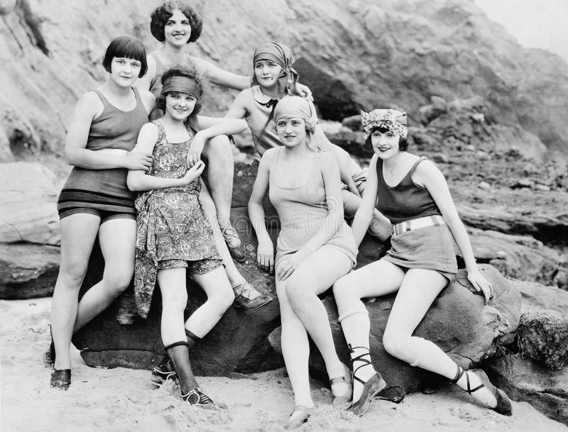 Six women posing at the beach. (All persons depicted are no longer living and no estate exists. Supplier grants that there will be no model release issues stock photos