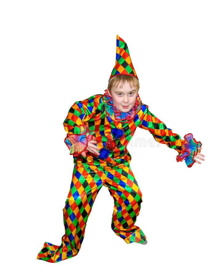 Six year old funny cute dancing boy in the clown suit. Without wig and makeup. Portert growth.. Isolated, on white background royalty free stock photography