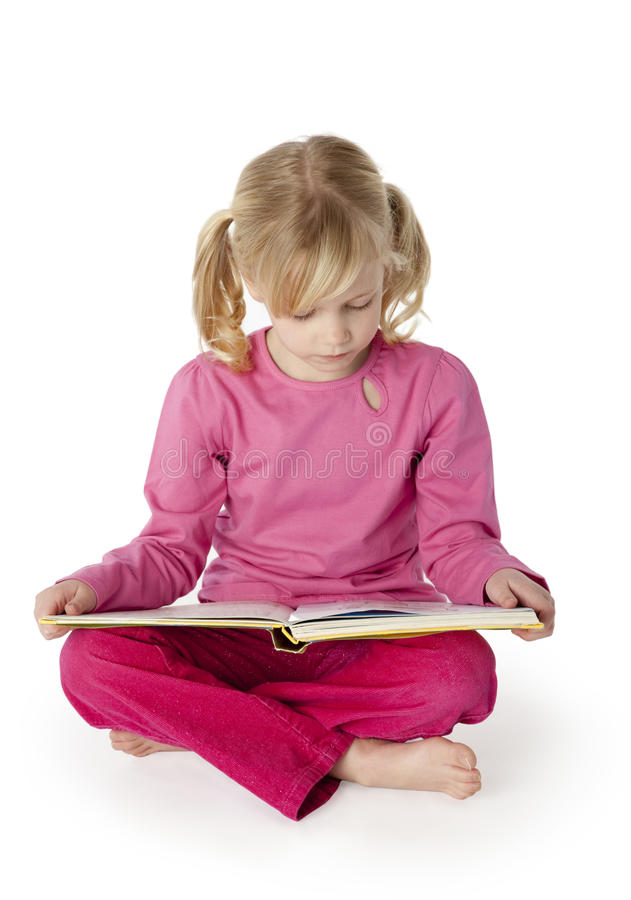 Six Year Old Girl Reading a Book stock images