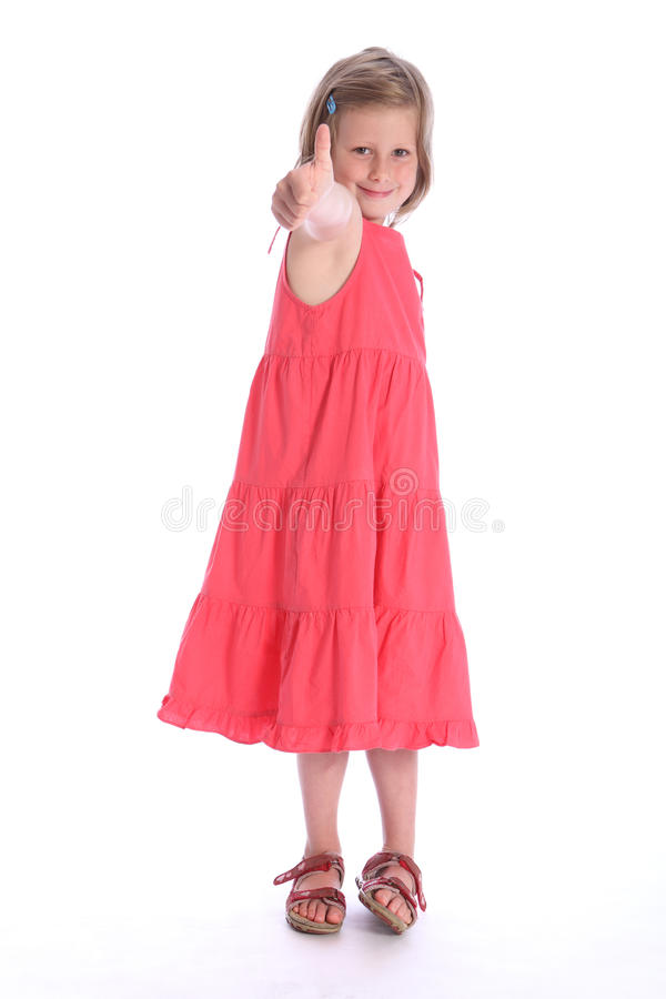 Six year old happy school girl success hand sign stock images