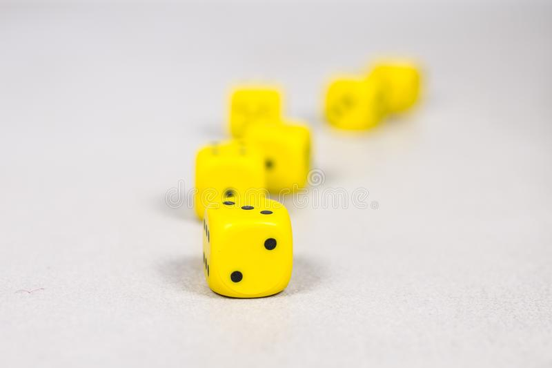 Six Yellow Dice Randomly Placed On  Clean Clear White Gray Grey Slated Background stock images
