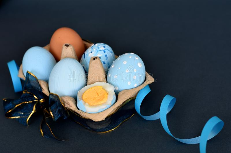 Sixpack of light blue colored Easter eggs decorated with ribbons royalty free stock photo