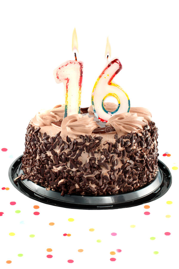 Sixteenth birthday or anniversary. Chocolate birthday cake surrounded by confetti with lit candle for an sixteenth birthday or anniversary celebration stock images