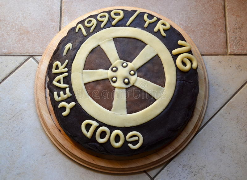 Sixteenth birthday cake. Birthday cake in form of tyre for my sixteenth son stock photography