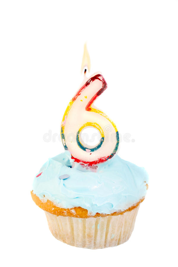Sixth birthday. Cupcake with blue frosting on a white background royalty free stock photos