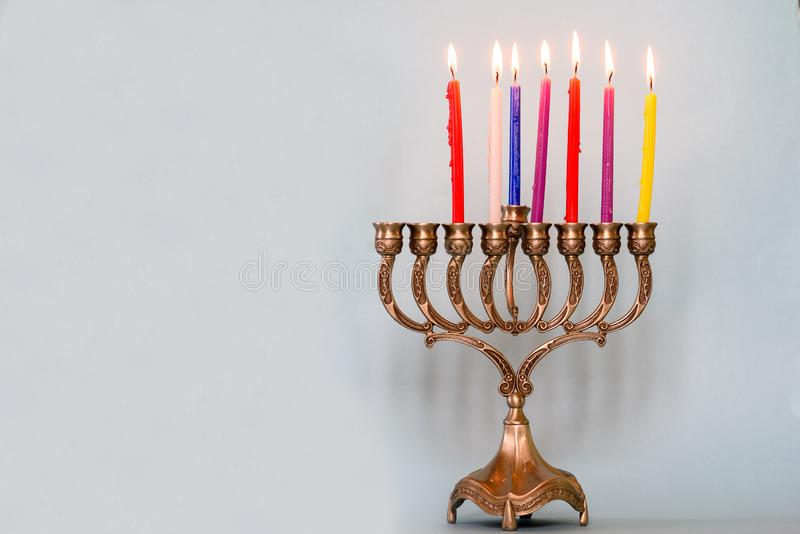 Sixth day of Hanukkah with burning Hanukkah colorful candles in Menorah.Chanukkah-jewish holiday. stock images