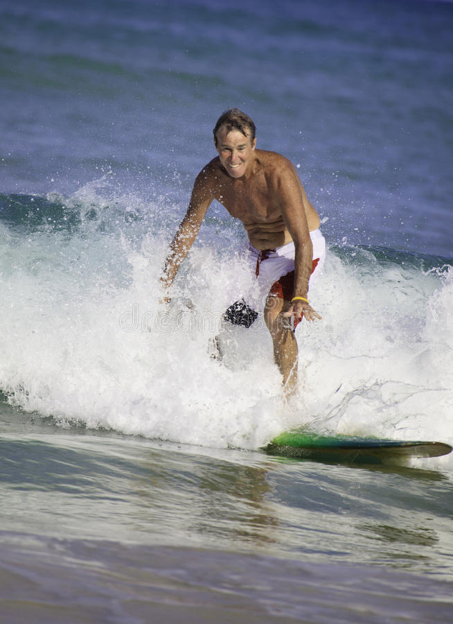 Download Sixty-four Year Old Man Surfing Stock Image - Image: 16789785