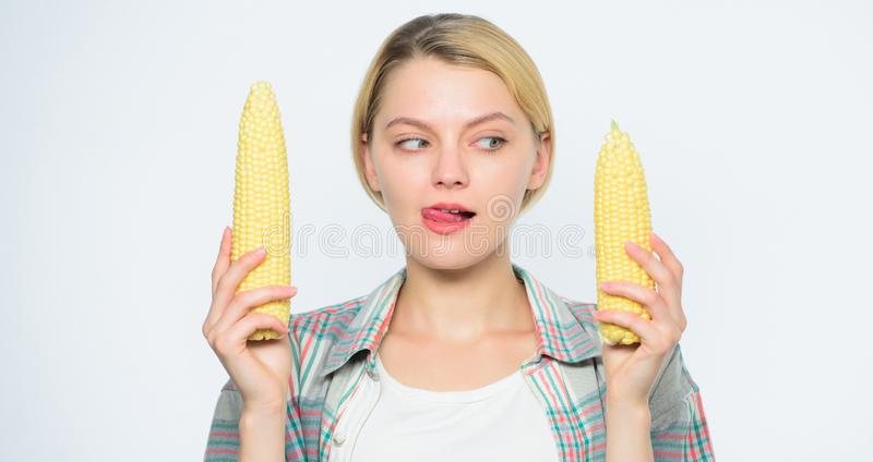 Size concept. healthy teeth. Farming, farmer girl with maize. corn crop. vitamin and dieting food. agriculture and. Cultivation. Happy woman eating corn stock photography
