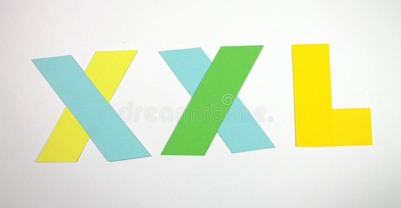 Size XXL.Birka size. Cut paper. XXL size tag isolated on white background close up stock image