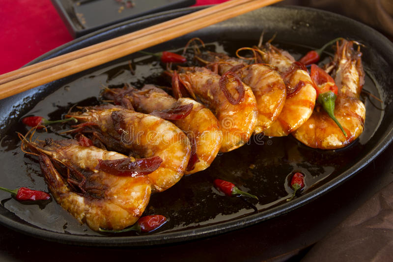 Sizzling Asian Prawns royalty free stock images